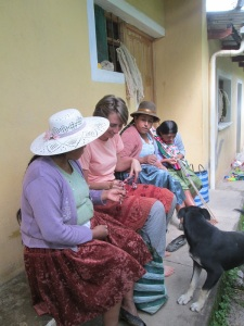 Annie and Gregoria Getting Help from the CdA Weavers
