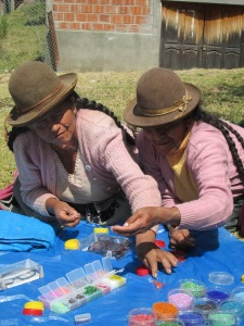 Doña Eulogia and Doña Justina Select Their Beads for Making Earrings