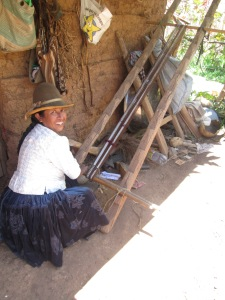 Doña Narciza at her loom weaving 2 straps at a time