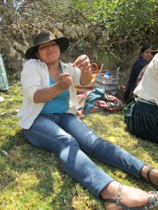Making Earrings at Ruraq Maki's Workshop Before Addressing the Women in Huancarani
