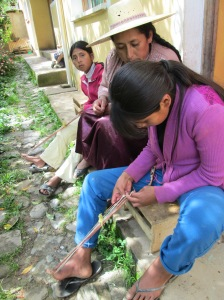 Veronica and Esther Learning to Weave Andean Figures