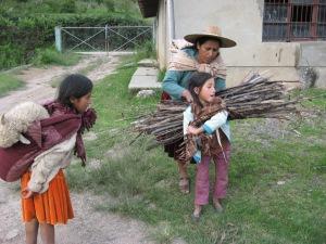 Doña Máxima Helping Mary Load Firewood, 2009