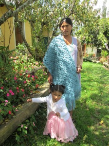 Adviana Models Shawl she Crocheted while Daughter Jhessica Frolics