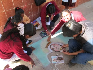 Josè Teaching the Madonnari Technique to 3 Students