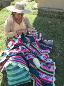 Vilma Crochets a Border on a Factory Made Aguayo