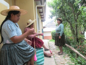 Vilma and Doña Máxima Plying Yarn for Their Next Weaving Projects