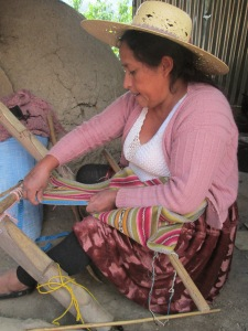 Doña Maxima Measuring a Weaving Before Cutting it Off the Loom
