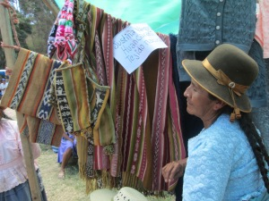 Doña Justina with Her Weavings Including Chuspas with Embedded Double Woven Figures