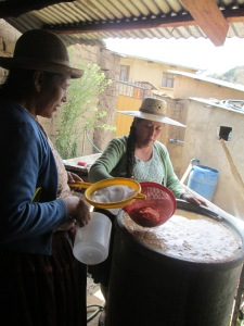 Scooping up Chicha Vinegar for the Dye Pots