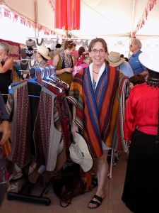 Marilyn Tries on a Stylish Poncho at the CTTC Booth at IFAM