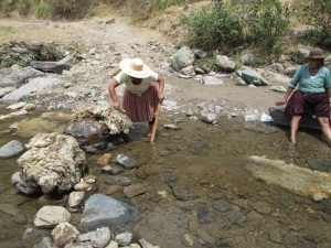 Doña Antonia Relaxing While Her Sheep Skin Rinse on the River Bottom